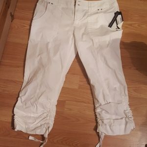 New with tags! White capris. Size 4.
